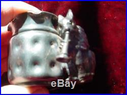 1800's Meriden # 54 toothpick holder Squirrel with glass eyes playing horn