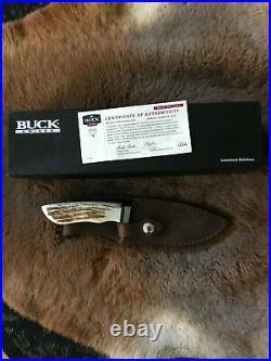 Buck 923 Wild Bill Cody Skinner with Turkey Feather inlay