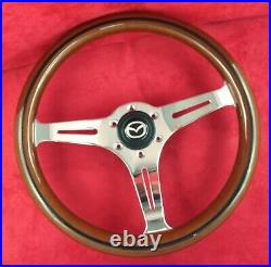 Classic wood rim, silver spokes 350mm steering wheel with Mazda horn button. 7B
