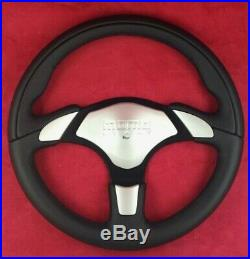 Genuine Momo X-Avion black leather 350mm steering wheel with silver horn pad