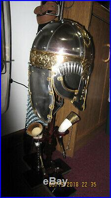 Reproduction Viking war helmet with chain mail and horn drinking cips